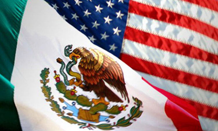 The American and Mexican flag are shown together, the the Mexican flag shown coming from the bottom-left corner, overlapping with the American flag coming from the upper-right corner.