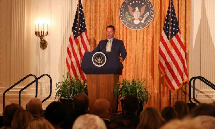 person giving a speech behind a podium