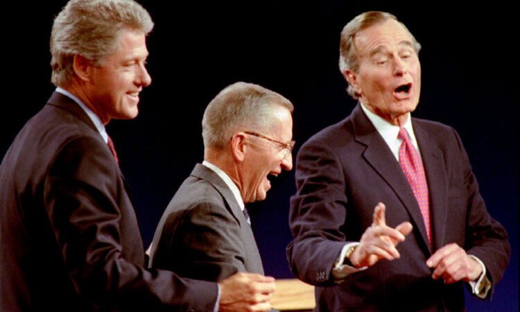 Democratic Presidential nominee Governor Bill Clinton (L) Independent candidate Ross Perot (C) and President George Bush laugh at the conclusion of their Presidential debate in East Lansing, Michigan, U.S., October 19th, 1992. REUTERS/Mark Cardwell/File Photo - S1BEUCTACFAB