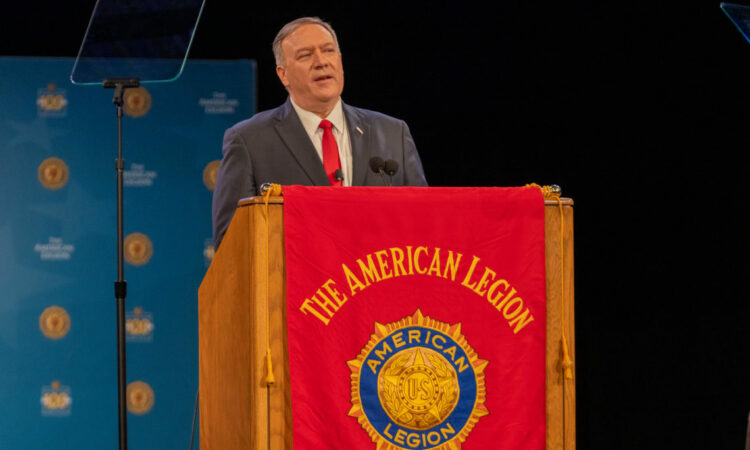 Person giving speech behind an American Legion podium