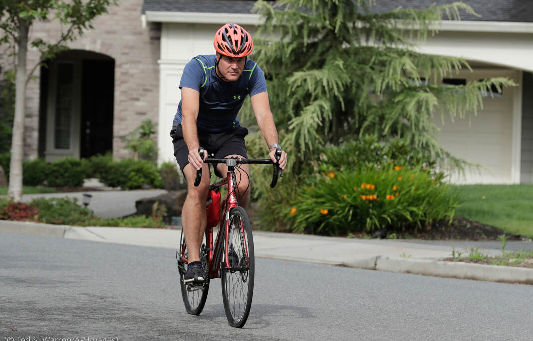 Neal Browning, the second person to receive a trial dose of a COVID-19 vaccine, rides his bike, Friday, July 24, 2020, in Bothell, Wash. As the world's biggest COVID-19 vaccine study gets underway more than four months after Browning and 44 others became the first participants in a phase-one coronavirus vaccine study that has produced encouraging results, more than 150,000 Americans have filled out an online registry in recent weeks signaling interest to volunteer for other studies, according to a virologist with the Fred Hutchinson Cancer Research Institute in Seattle. (AP Photo/Ted S. Warren)