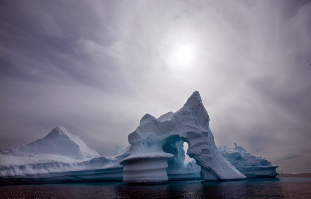 FILE - In this July 19, 2007 file photo an iceberg is seen off Ammassalik Island in Eastern Greenland. A new assessment of climate change in the Arctic shows the ice in the region is melting faster than previously thought and sharply raises projections of global sea level rise this century. (© John McConnico/AP Images)