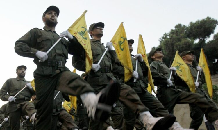 Soldiers marching with yellow flags.