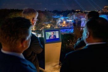 Men staring at a monitor.