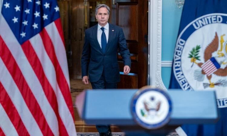 Secretary Blinken walking towards lectern