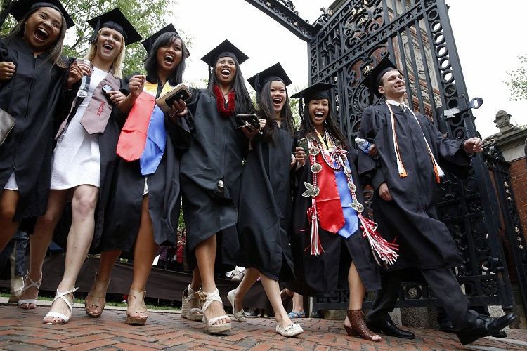 Brown University graduates pass through the Van Winkle Gates during the procession before commencement ceremonies in Providence, R.I., Sunday, May 26, 2013. (AP Photo/Michael Dwyer)