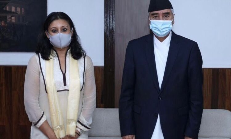 Man and Woman stand side by side wearing masks (Twitter).
