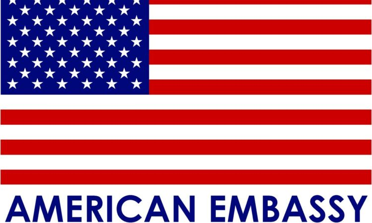 American flag with American Embassy