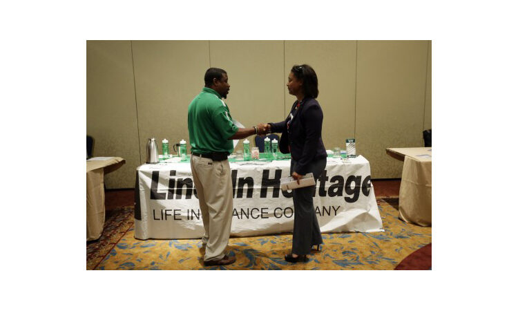 Recruiter and job seeker shaking hands (AP Images)
