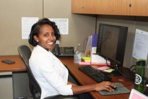 Woman at desk (Courtesy of Rigbe Gebrehawariat)