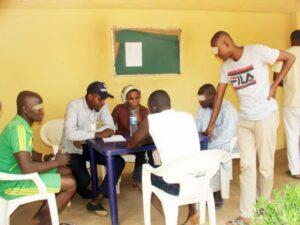 Rukayya counseling male inmates at a prison in Kuje