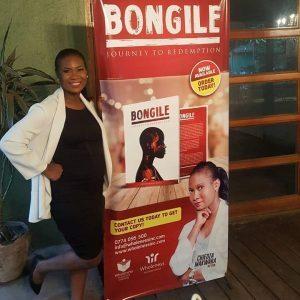 Chiedza Makwara in front of sign