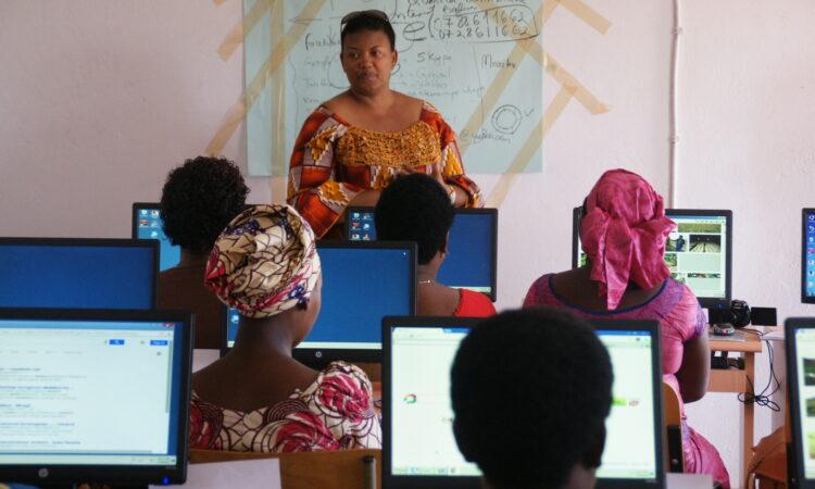 Solange Murekezi teaching girls computer skills