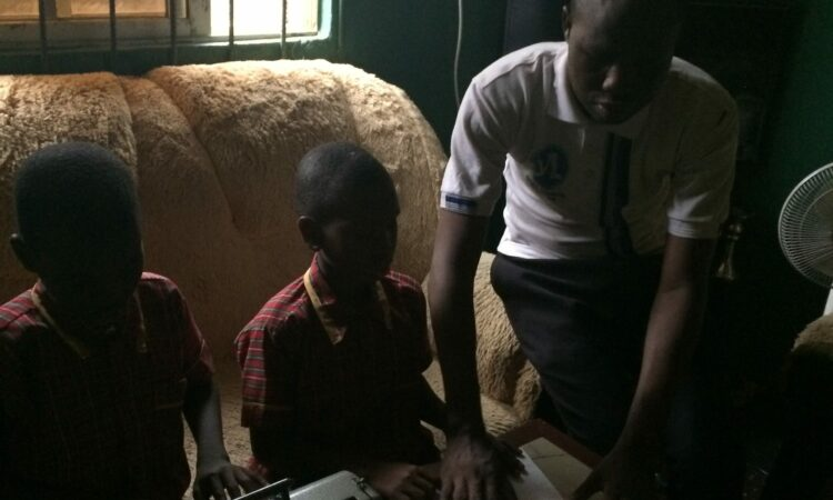 Adesola helps a student