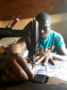 Philip recycles discarded and disinfected plastics into sheets through the organization Full Circle Africa.