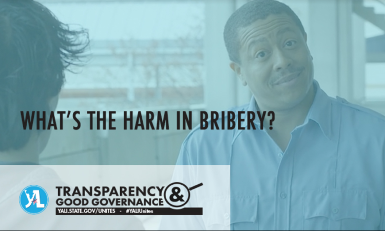 """Man wearing security uniform with text reading """"What's the harm in bribery?"""""""