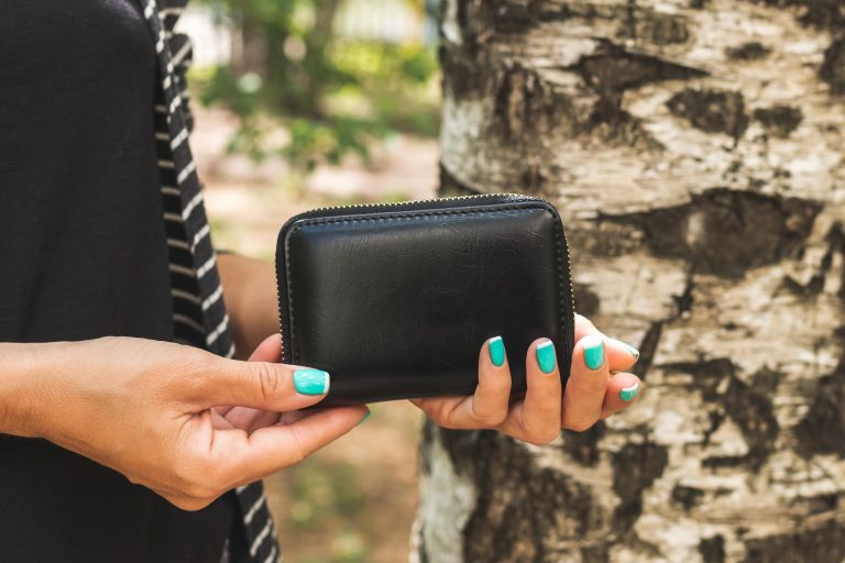 Picture of a woman holding a wallet