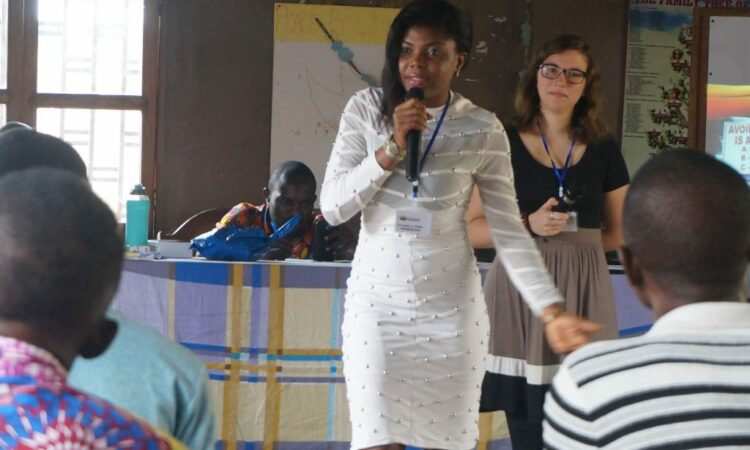 Blessing presenting on the role of youth in combating teenage pregnancy, backstreet abortion, and drug abuse in Cameroon