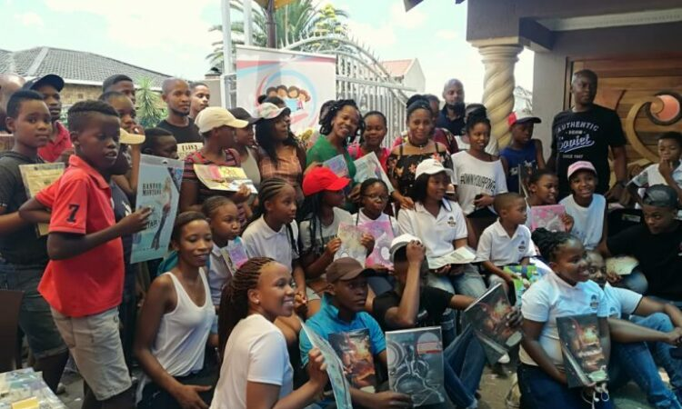 Loatile and students at a book drive in July 2018