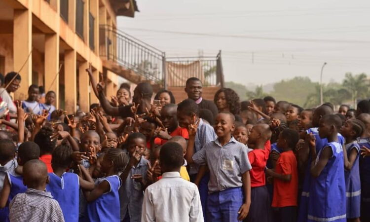Iheanyi and students at the New Haven Primary School in Nigeria