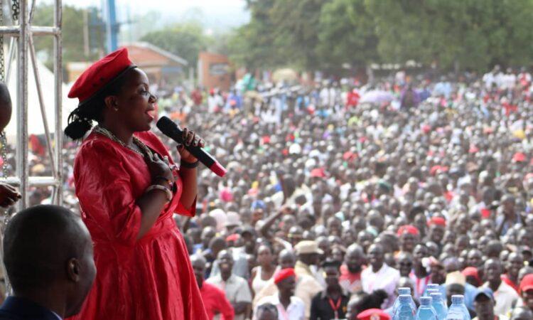 Flavia addressing a political rally in Uganda
