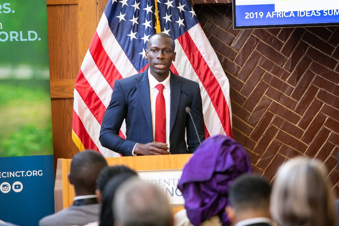 Ebrima delivering remarks in 2019 at the University of Virginia on the Gambian Truth, Reconciliation, and Reparations Commission