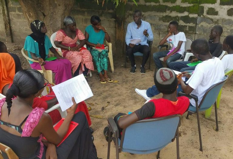 Ebrima leading a ChildFund session on team building in 2015