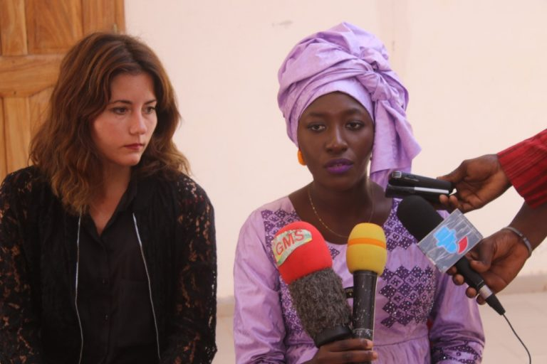 Thioro speaking to reporters in 2019 about a training she led on gender, nonviolent communication, and business leadership