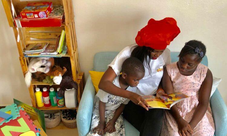 Maimouna teaching children at AfroKids