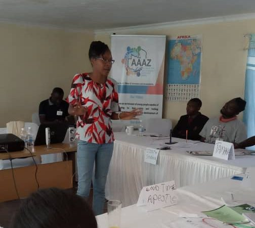 Christabel delivering a presentation on transparency and accountability
