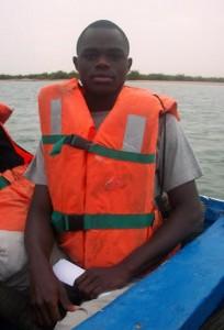 Man sitting in a canoe (Courtesy of Faye Ndiaga)