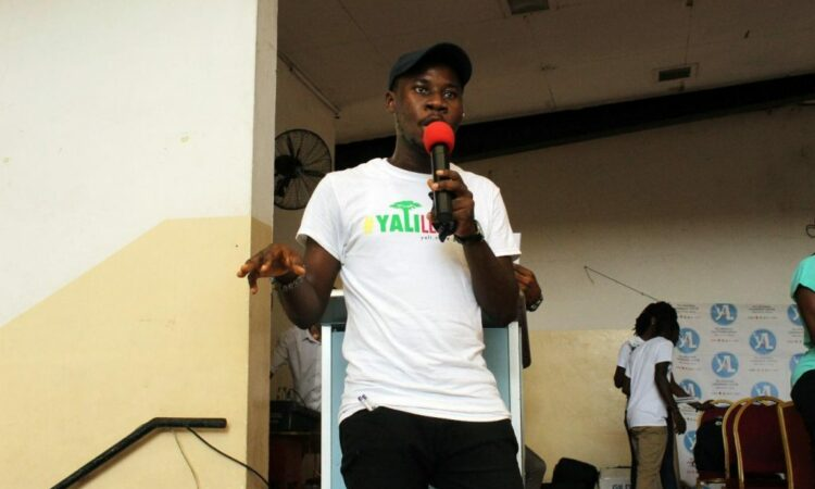 Isaac addressing participants at his YALILearns session in Ghana