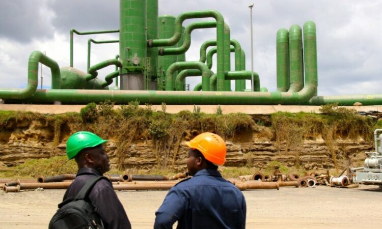 Two men in hard hats at a geothermal plant (Carole Douglis/USAID West Africa)