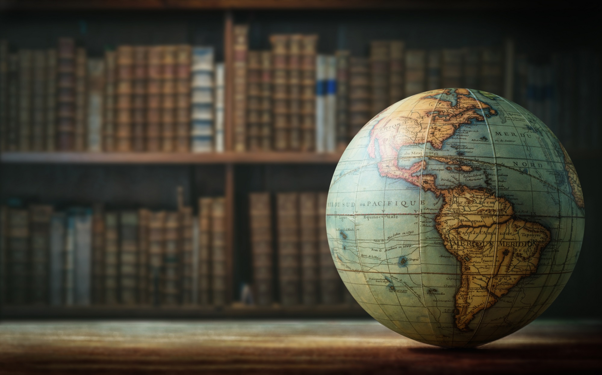 Globe and bookshelves
