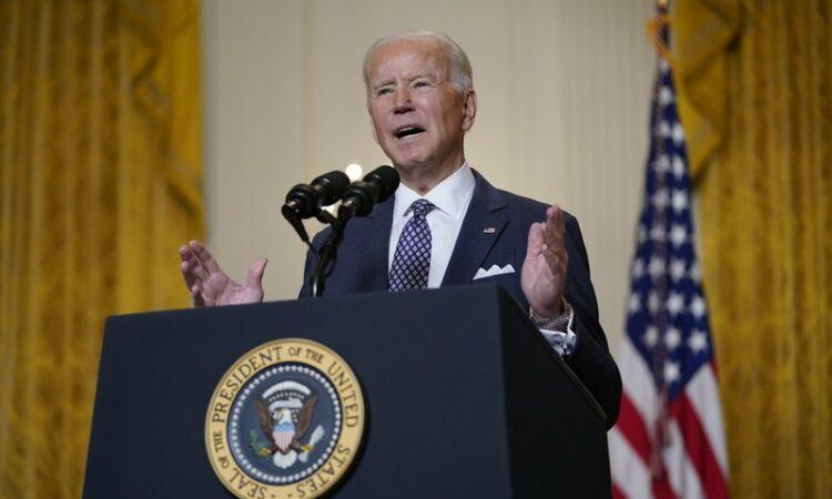 President Biden speaks at podium