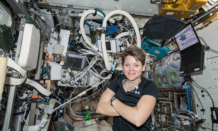 NASA astronaut Anne McClain inside the Destiny laboratory module surrounded by exercise gear on Dec. 14, 2018