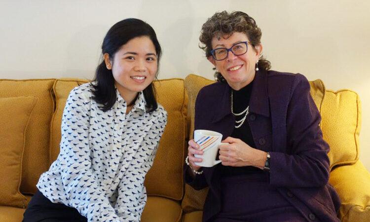Carolyn Glassman sitting with a young woman