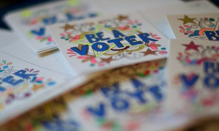 """Hand drawn cards reading, """"be a voter"""""""