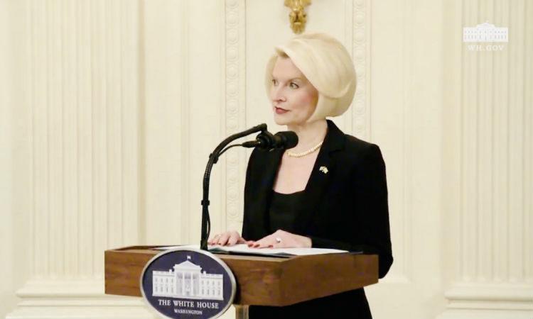 Ambassador Gingrich giving a speech at a lectern