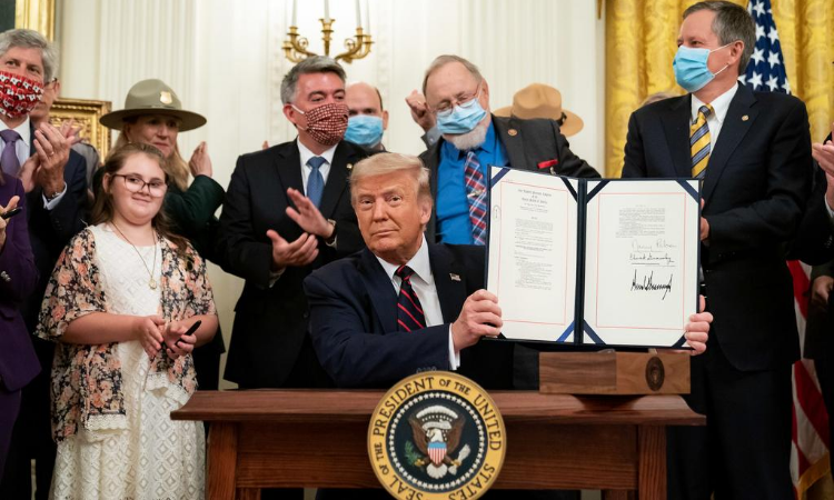 President Donald J. Trump displays his signature after signing H.R. 1957- The Great American Outdoors Act Tuesday, August 4, 2020, in the East Room of the White House. (Official White House Photo by Tia Dufour)