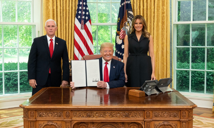 President Trump with First Lady and Vice President signing Religious Freedom