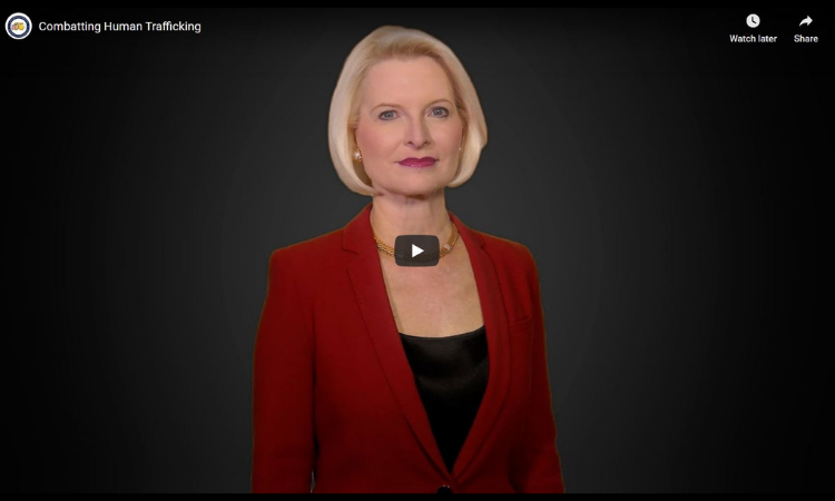 Ambassador Gingrich video message red outfit