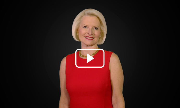 Ambassador Gingrich posing for a Christmas greeting video in a red dress