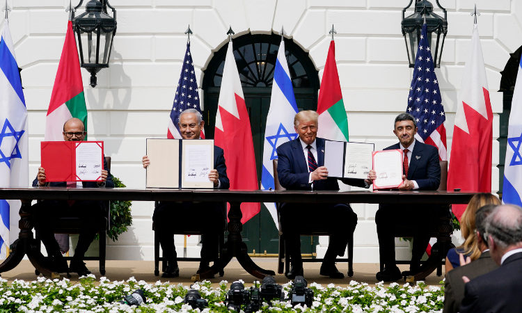 President Donald Trump, center, with from left, Bahrain Foreign Minister Khalid bin Ahmed Al Khalifa, Israeli Prime Minister Benjamin Netanyahu, Trump, and United Arab Emirates Foreign Minister Abdullah bin Zayed al-Nahyan, during the Abraham Accords signing ceremony on the South Lawn of the White H