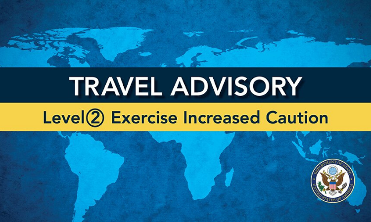 Travel Advisory with yellow banner on world map