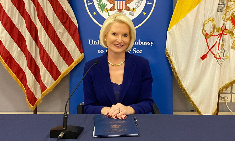 ambassador gingrich posing for a photo in a blue outfit